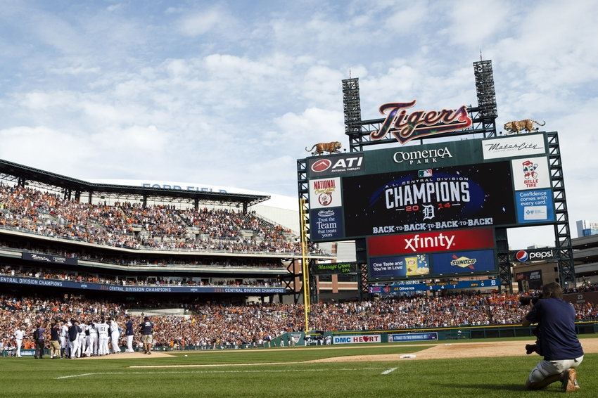 Sep 28, 2014; Detroit, MI, USA; Detroit Tigers players celebrate after the game against the Minnesota Twins at Comerica Park. The Tigers clinched the ...